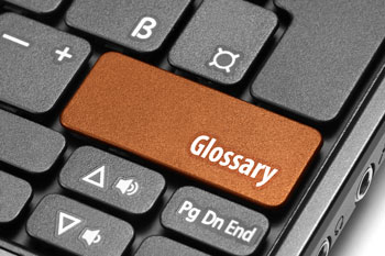 The idea of garage door glossary is illustrated by this image of a computer keyboard with a key labeled with the word Glossary.